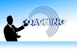 """Blaues Bild mit Schrift """"Coaching"""""""